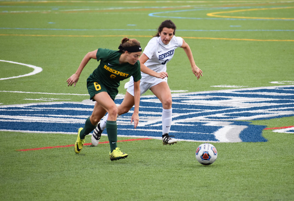 Junior defender Sarah Lefrois chases down her opponent during a game against SUNY Brockport on Saturday Oct. 13. The Knights would secure a 1-0 victory in the matchup. (Josie Kwan)