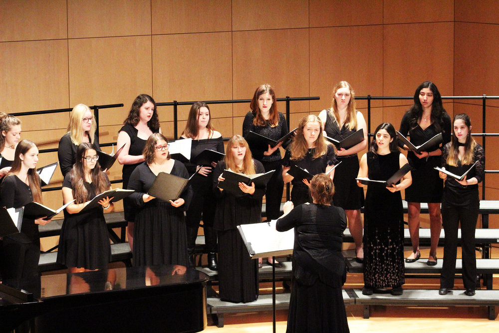 "The Spectrum Singers (pictured above) and the Geneseo Chamber singers performed in the fall chorus concert ""Interludio musicale d'autumno"" on Sunday Oct. 21. The songs they sang varied from the Spanish song ""Portones Abiertos y Rostros Brillantes"" to a Bob Dylan arrangement (Catherine White/editor-in-chief)."