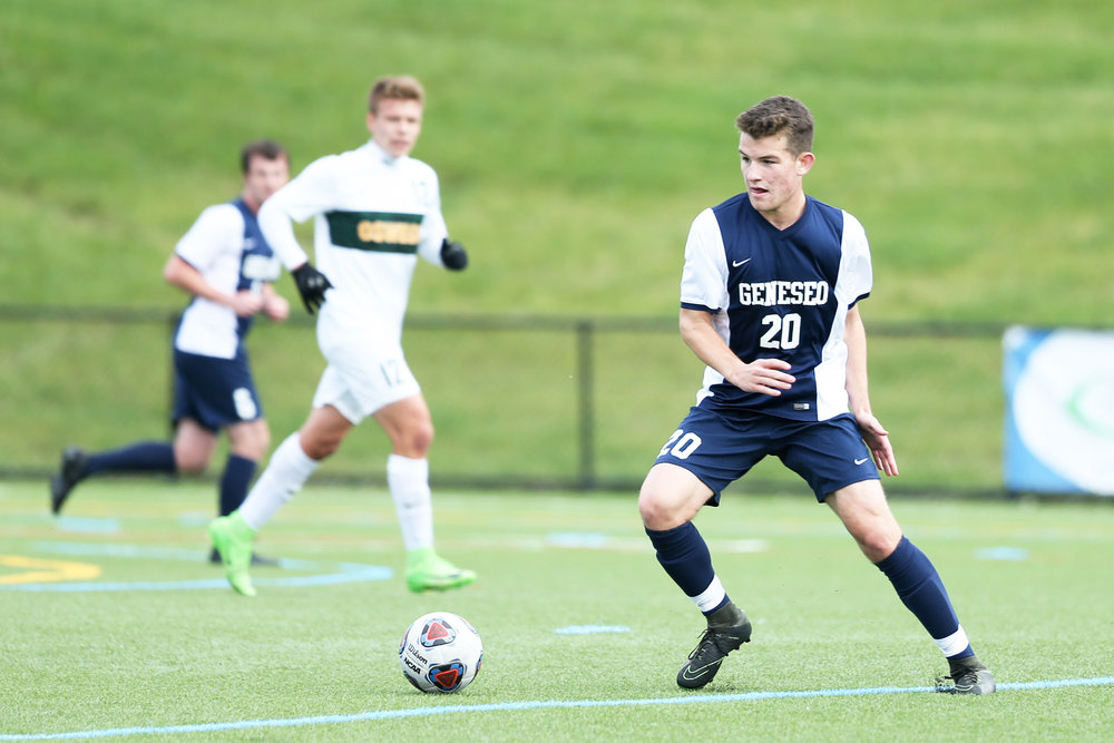Sophomore midfielder Marco LaRocca (pictured above) controls the ball through the center of the field in a matchup against SUNY Oswego. The game would result in a 0-0 draw for the Knights (Keith Walters/director of multimedia).