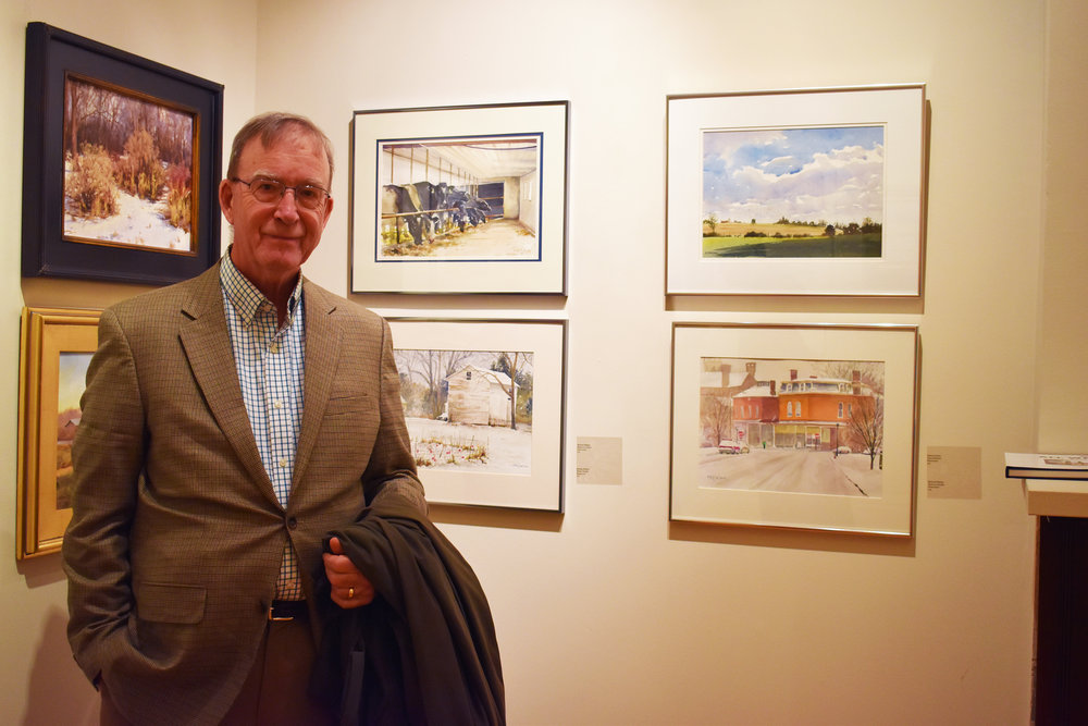 The All Weather Gang is a group of eight artists, including Michael Killelea (pictured above), who collaborate to create paintings of realistic settings. The Lockhart Gallery opened the display on Oct. 24 (Josie Kwan/assoc. photo editor).