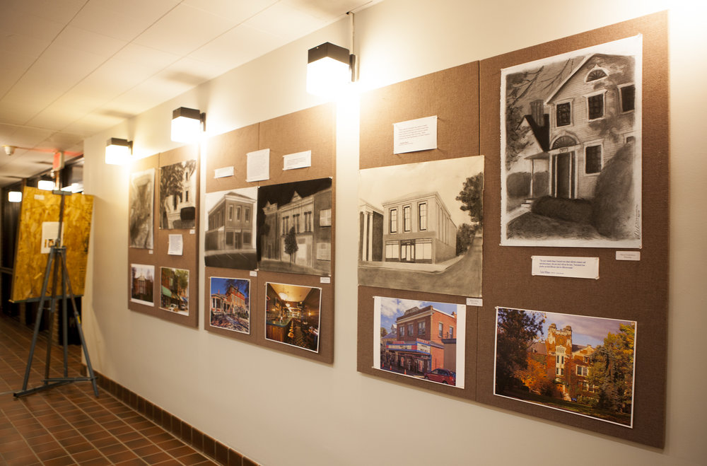 "The ""Five Geneseo Businesses: Culture and Commerce on Main Street"" exhibit (pictured above) opened Wednesday Dec. 5 in the Bridge Gallery. This exhibit showcases establishments on Main Street. (Udeshi Seniveratne / photo editor)"