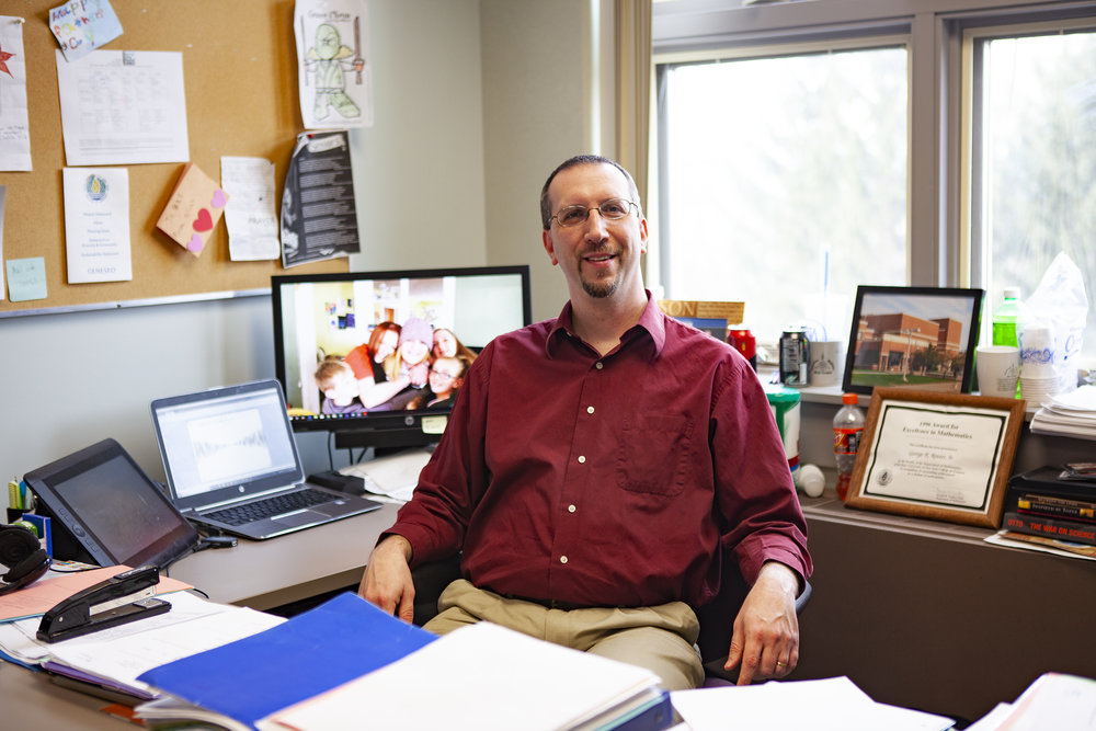 Geneseo alumnus George Reuter '96 (pictured above) became a teacher at Geneseo Central High School following graduation. In 2013, Reuter returned to his roots and became a mathematics professor at Geneseo where he practices his unique teaching style focused on engaging students (Udeshi Seneviratne/photo editor).