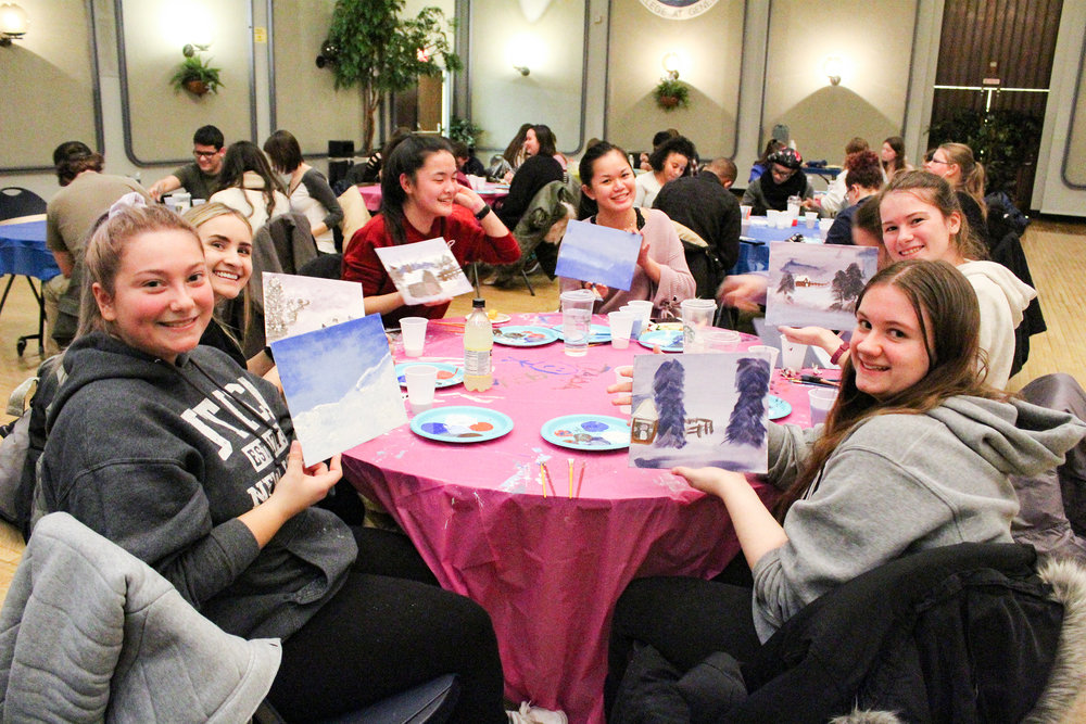Geneseo Late Knight put on an event in the Union Ballroom for students to paint along with a video of artist Bob Ross on Jan. 26. Bob Ross is famous for his follow-along painting videos. Students enjoyed using this event to make intricate creations (Catherine White/editor-in-chief).