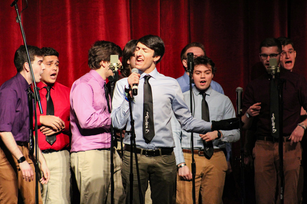 """Geneseo a cappella groups Between the Lines, Emmelodics, Southside Boys, Exit 8 and Hips N' Harmony performed in Wadsworth Auditorium on Friday March 8. This charity concert donated money to the American Foundation for Suicide Prevention. A highlight of this concert was """"Billie Jean"""" by Southside Boys member Evan Panzer (pictured above) (Catherine White/editor-in-chief)."""