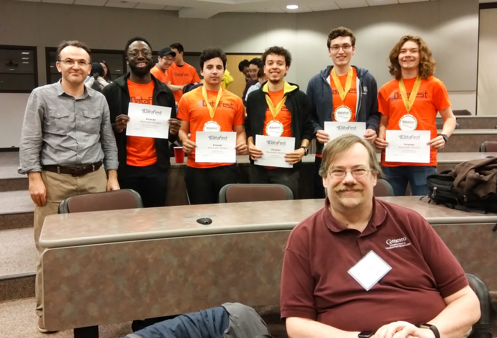 """The """"Newton's Knights"""" team and two Geneseo faculty who volunteered as consultants and judges (pictured above) attended Datafest at The Rochester Institute of Technology. The group won second place in the competition (courtesy of yusuf BILGIç)."""