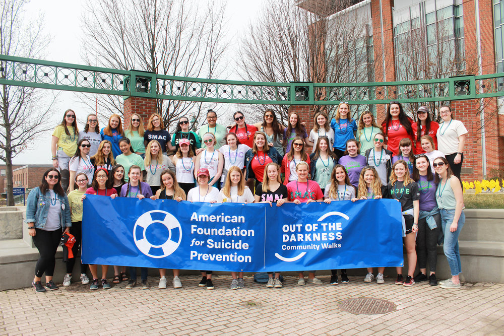 """The Geneseo community came together to participate in SMAC's annual """"Out of the Darkness"""" walk on Sunday April 7 to raise both proceeds and awareness to support a great cause. Students, faculty and community members walked two miles around Geneseo's campus and more than $10,000 was raised for suicide awareness (courtesy of Hunter Siegel-Cook)."""