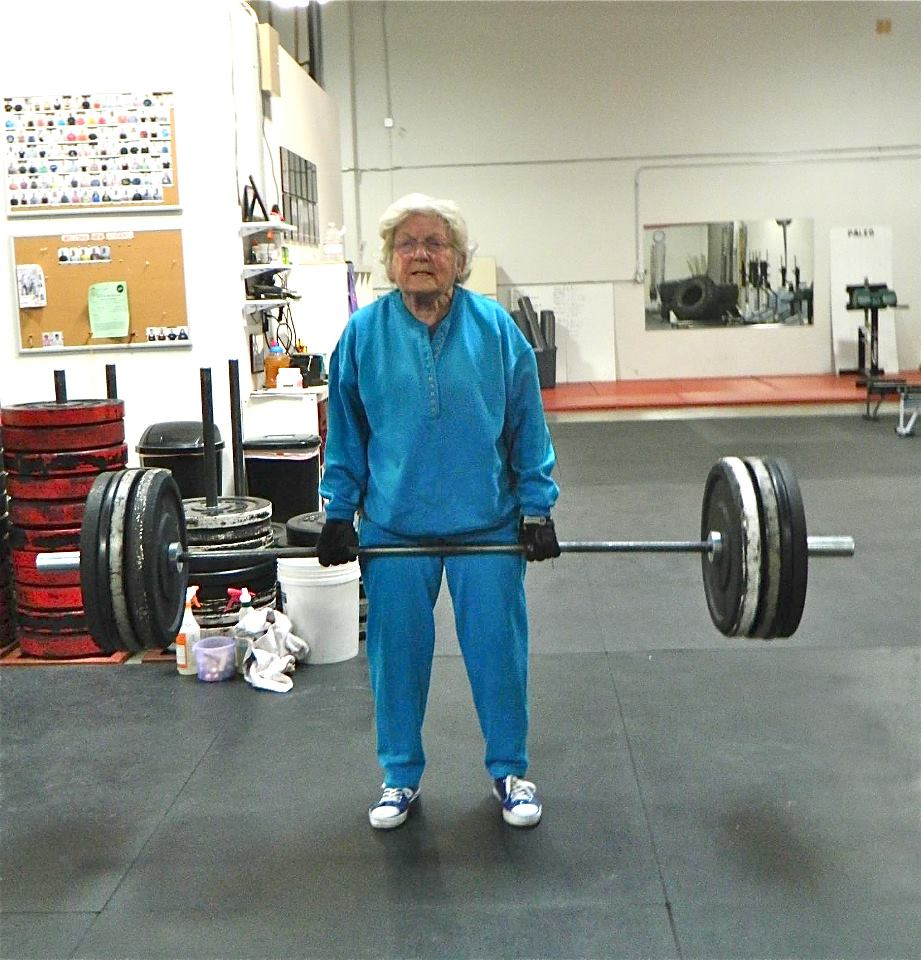 Age does not necessarily mean your back will be weak. Jean Stewart (pictured) began weights training at age 83, seen here dead lifting 153lbs. Photo credit: Huntersville Crossfit -