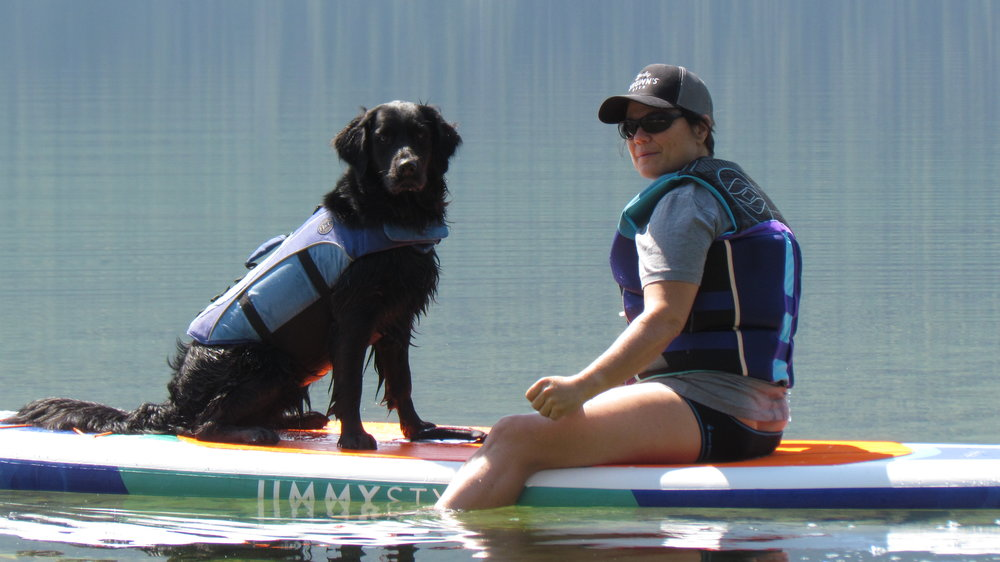 Juno and I paddle boarding on the lake.