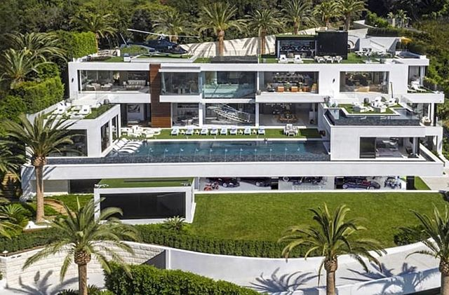 When you need space for the cars and helicopter!! We can only imagine what the kitchen looks like. #luxury #luxuryrealestate #luxurydesign #mansion