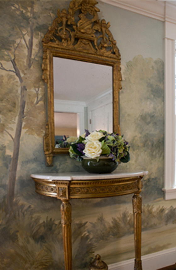 Don't be afraid to hang mirrors or other art pieces on top of a mural for a rich, layered effect.