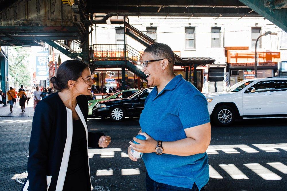 Alexandria Ocasio-Cortez, left, and Kerri Evelyn Harris, right.  Photo by Kerri Evelyn Harris, CC-BY 2.0.
