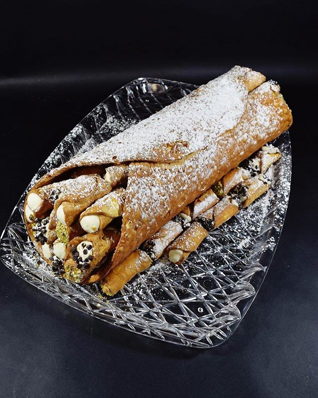 Check out our XL cannoli! It's a giant cannoli shell filled with tons of mini cannolis! We offer different fillings and toppings for you to mix and match for the cannolis. A fun and delicious addition to any party :) call (585)454-6979 or stop in today to order! #gruttadauriasbakery