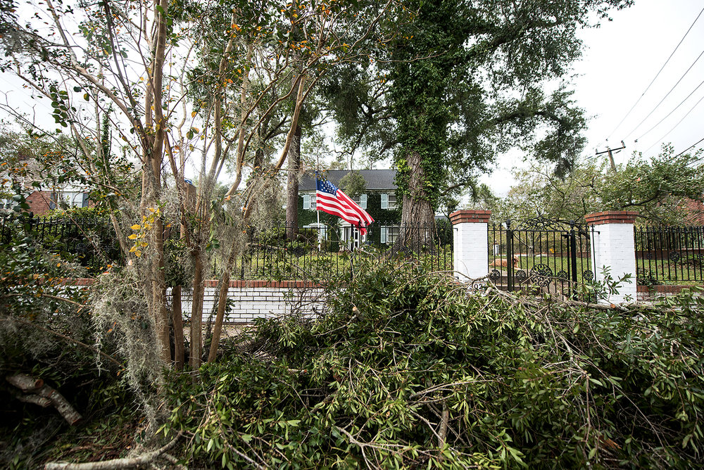 A lone American flag flew in Wilmington, N.C., on Monday, four days after Hurricane Florence slammed the city, leaving it isolated.