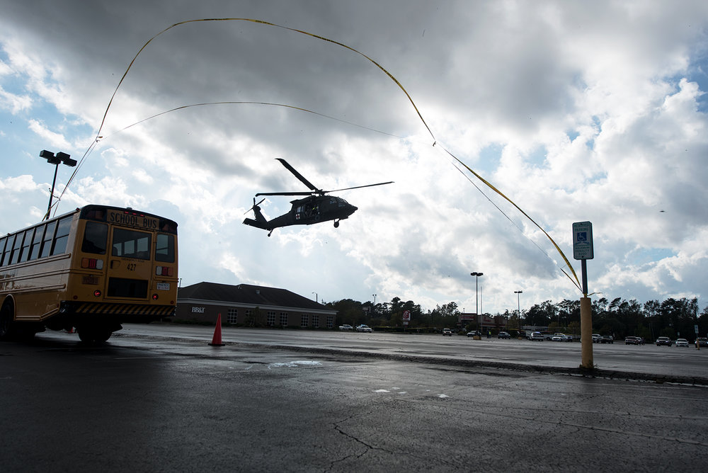 The United States National Guard and Coast Guard, bring evacuees mostly from Brunswick and Pender county, in the K&W parking lot in Wilmington, N.C., on September 18, 2018. These evacuees come from high flooded areas where the Cape Fear River is cresting over.
