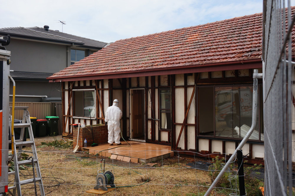 Hosing down house that contains asbestos