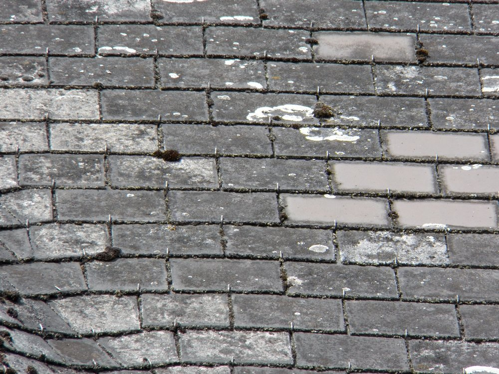 Although they might look like slate, these shingles are actually made out of asbestos fibre and cement.