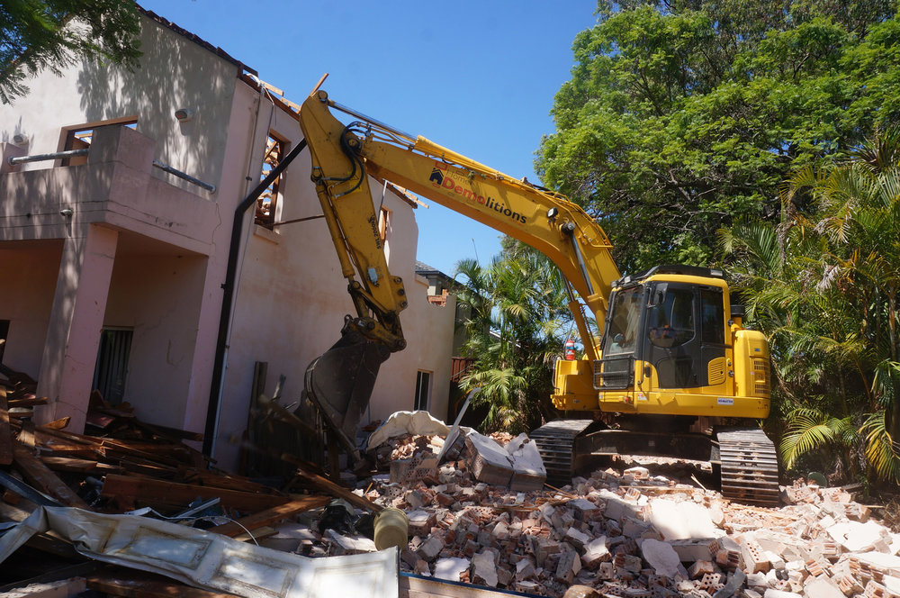 Demolition in progress of brick house in Strathfield