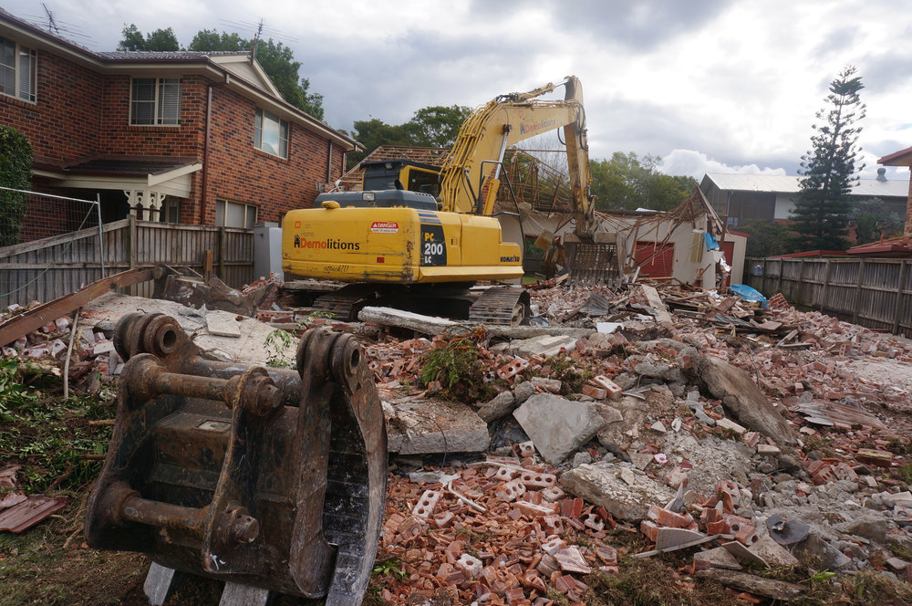 Behind shot as excavator demolsihes house in west Ryde.jpg