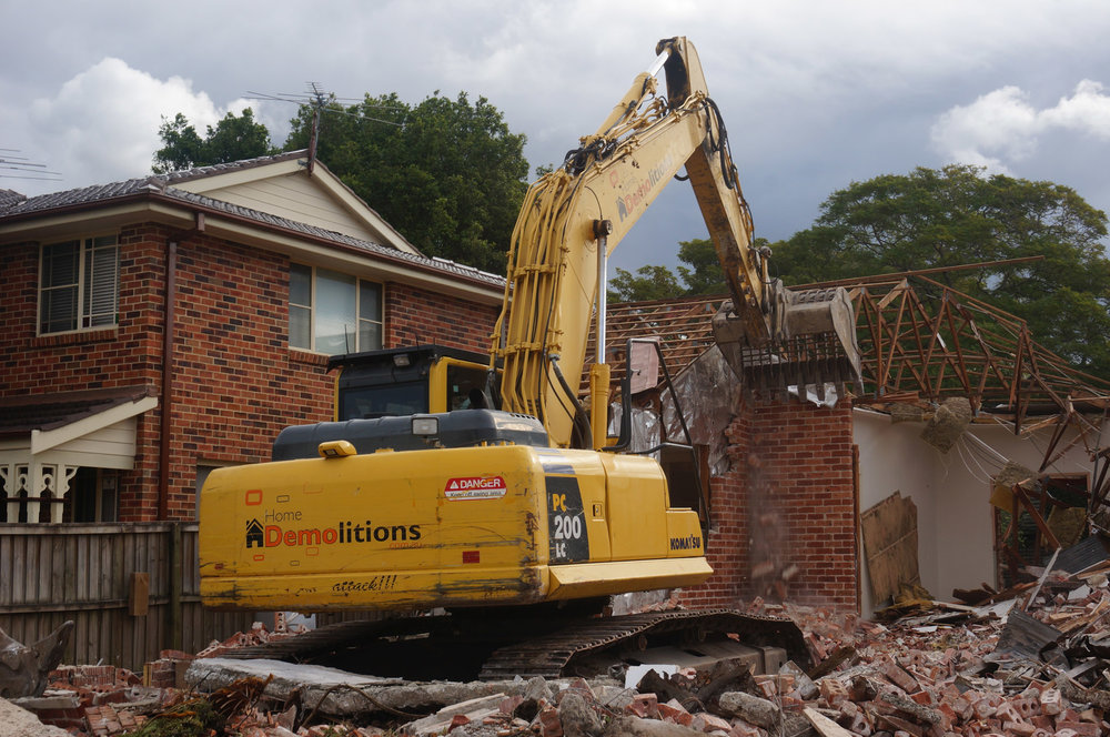 Brick wall mid-demolition in West Ryde.jpg