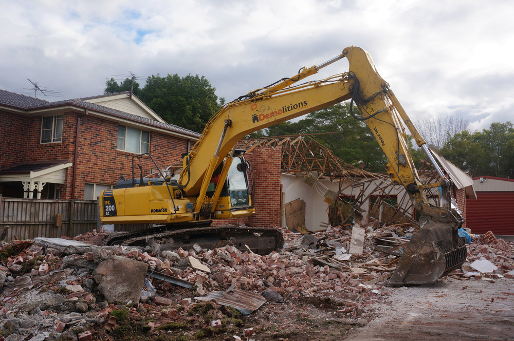 Excavator hard at work at demolition site in west Ryde.jpg