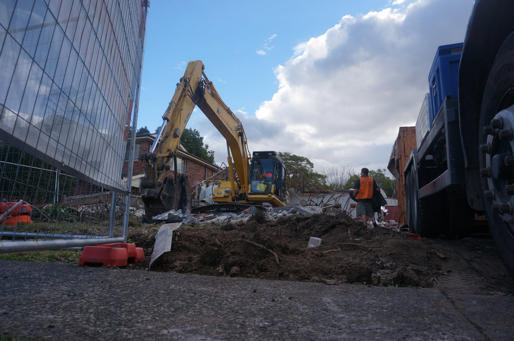 Low angle shot of excavator on demolition site in West Ryde.jpg