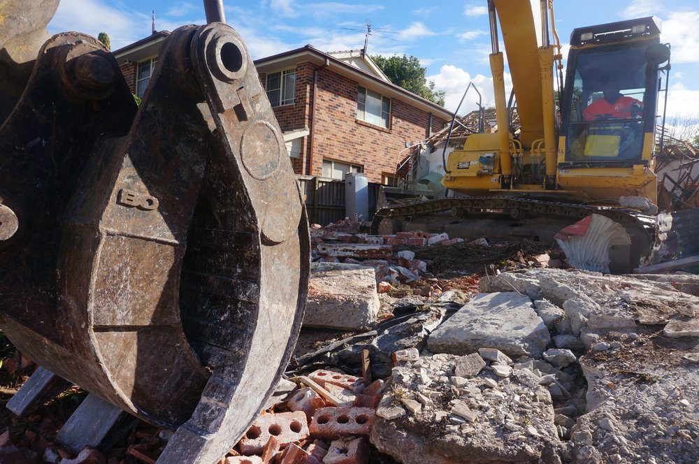 Low angle shot of excavator of demolition site in West Ryde.jpg