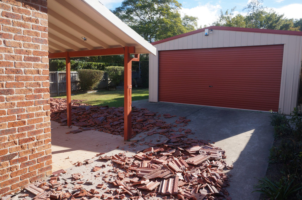 Tiles smashed on ground at house due for demolition in West Ryde.jpg