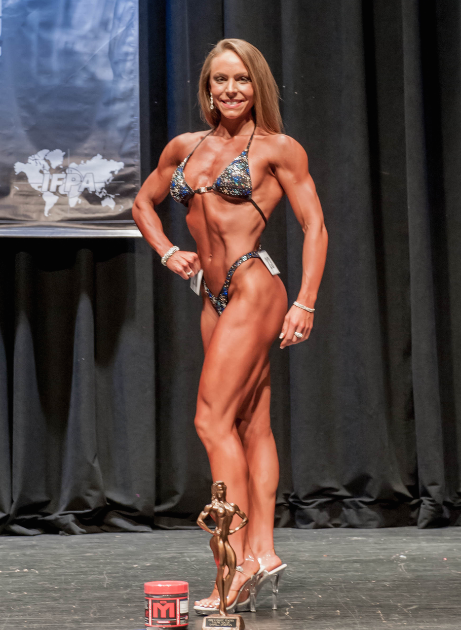 Winning my IFPA Natural Figure Pro card the following weekend in DeKalb, Illinois. [Told you I was crazy doing three events in three weekends ;)] Winning the overall title, tall class title, and novice category. 140lbs.