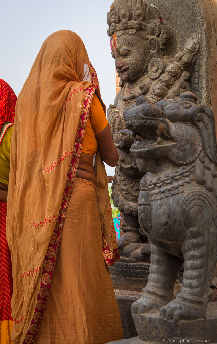 During one of my last photo shoots in Kathmandu, I came across these Hindu women who were praying to one of the gods at the top of the stairs of this holly site.