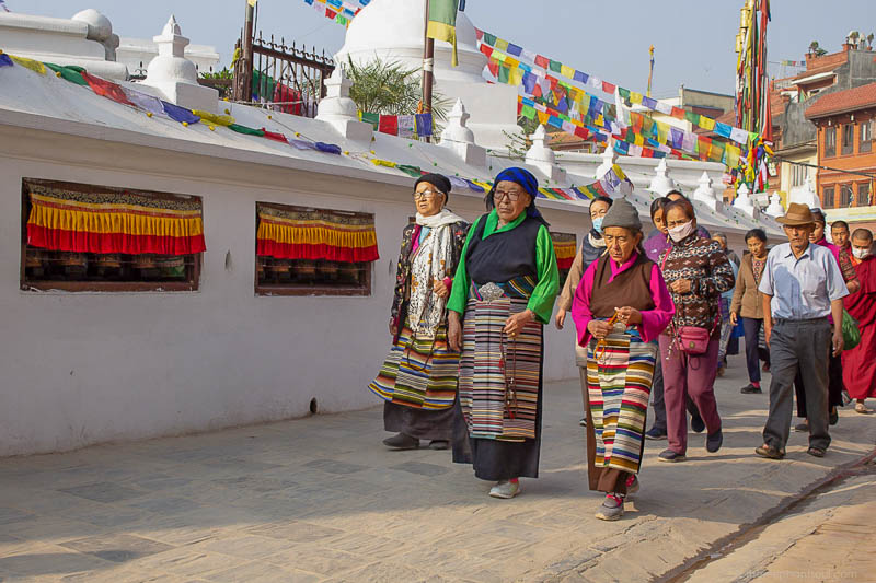 This photo was taken at Bouddhanath in Kathmandu, Nepal, my home during five years. Women in the photo are Tibetan Buddhists that go on their daily walks praying around the stupa.