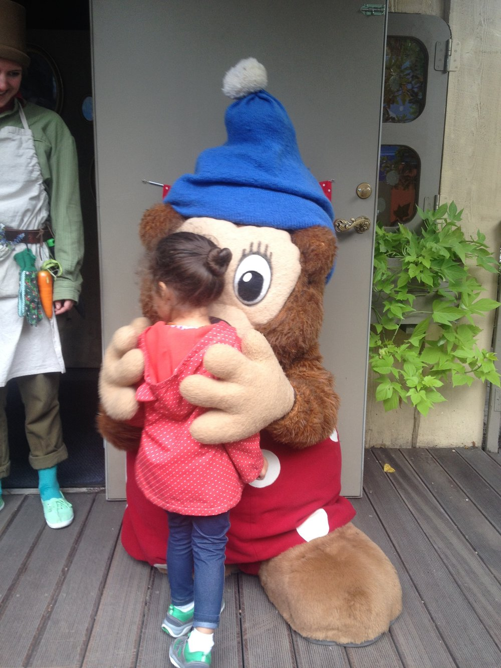 My daughter getting a hug from Rasmus Klump Bamse which is a Danish kids book and TV character at Tivoli