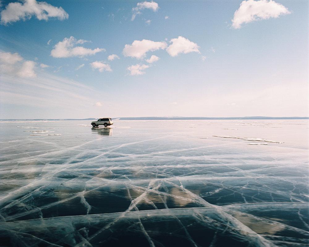 Crossing the frozen Lake Khovsghul in winter on the Siberia-Mongolia border