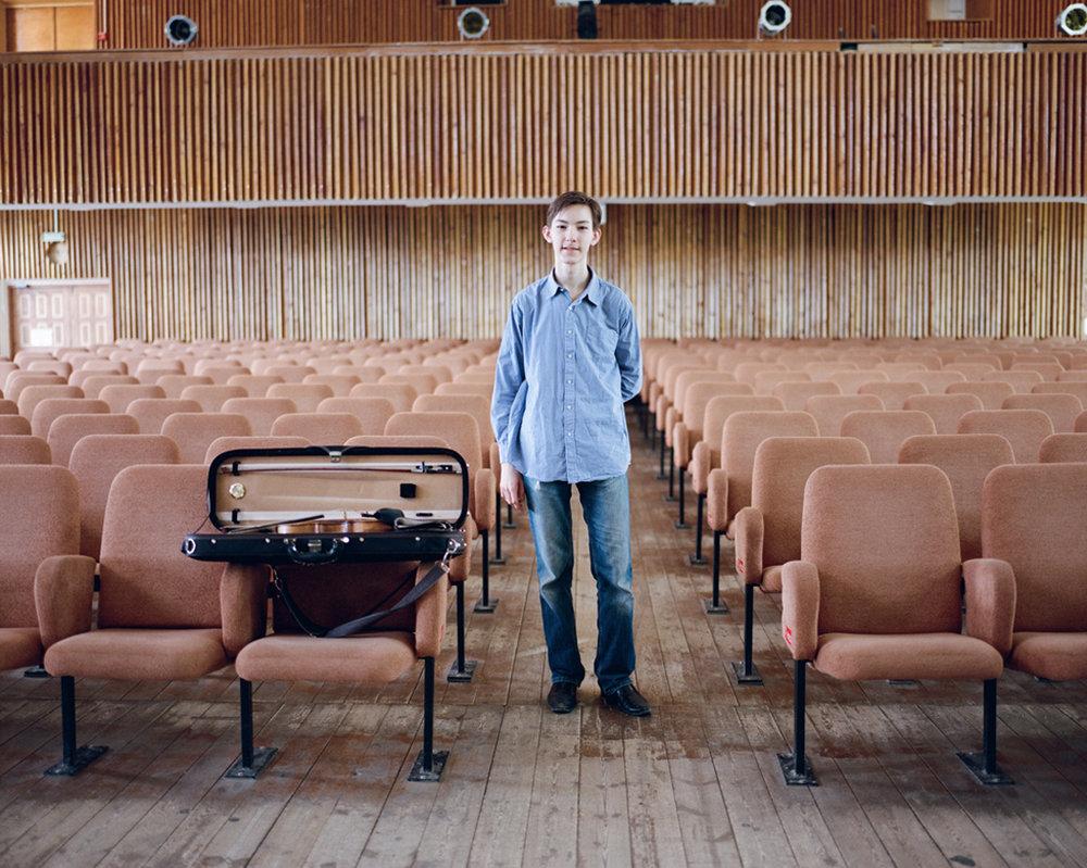 Child prodigy Ravil Islaymov, aged 15, photographed at the Yakutsk Philharmonic in July 2016