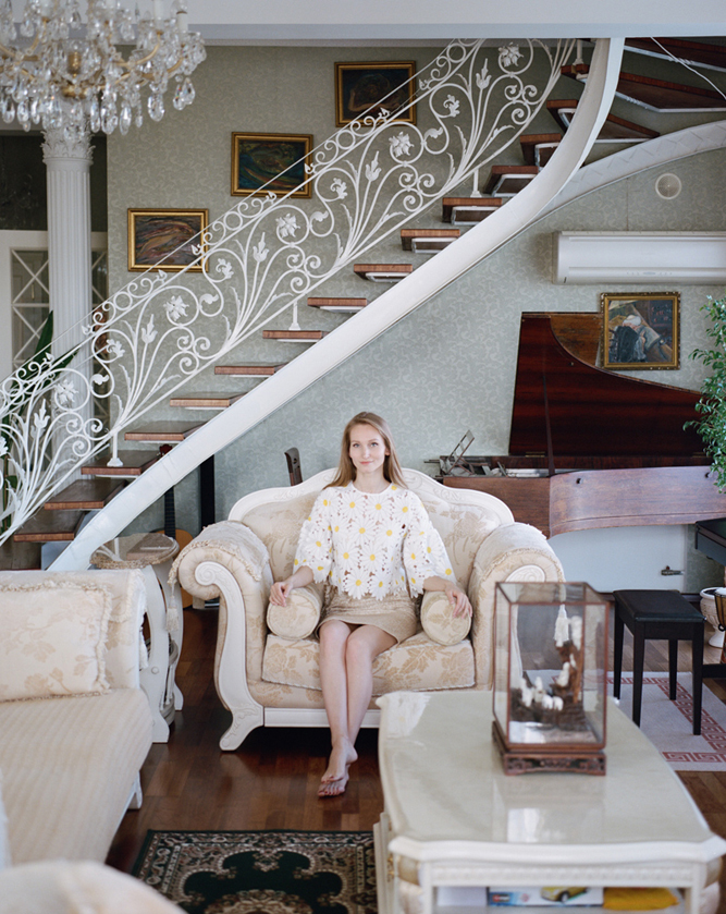Alana Khidorova photographed in the drawing room of the family's Khabarovsk apartment beside a Sturzwage baby grand