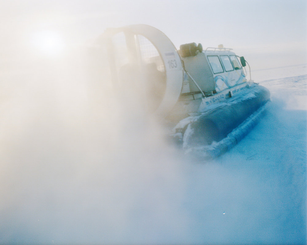 Crossing a frozen Lake Baikal in winter using a local hovercraft