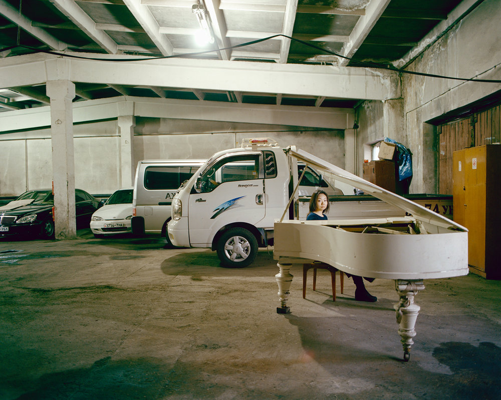 Concert pianist Odgerel Sampilnorov and the Moscow-manufactured Edward Ivanlusky 'Garage Piano' in an Ulaanbaatar car park