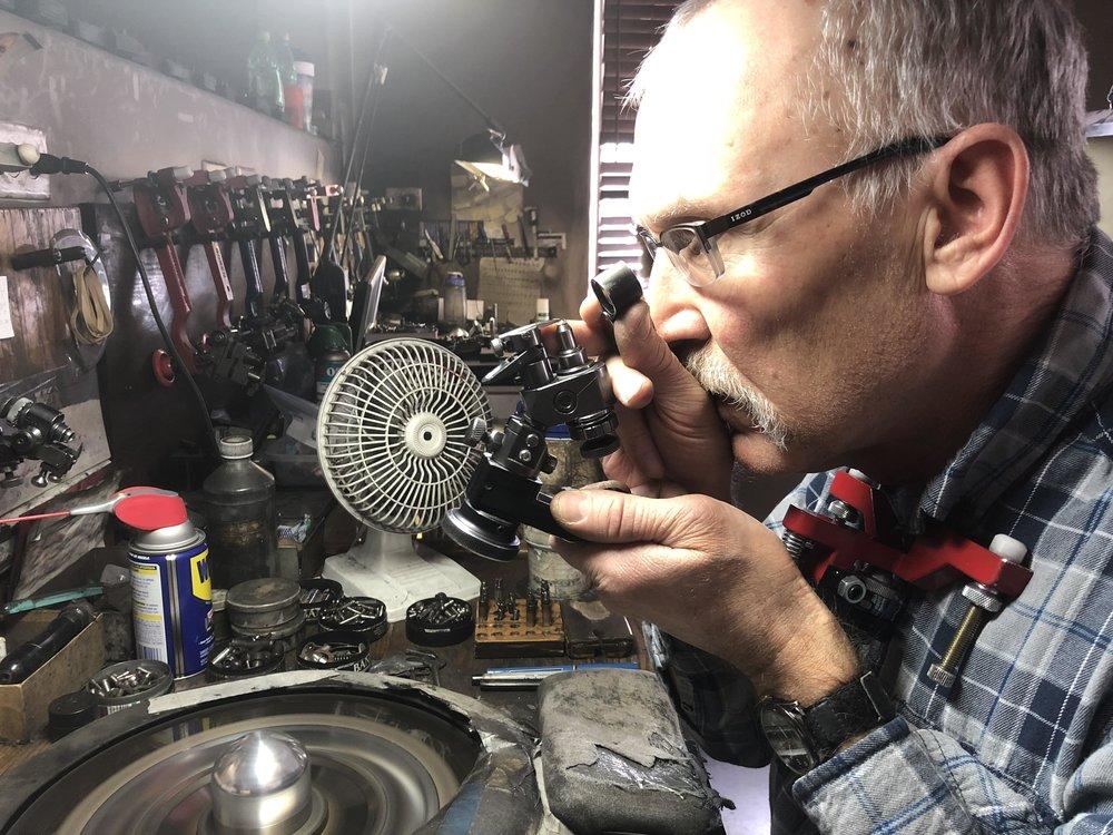 Diamond Cutter Examining Stone