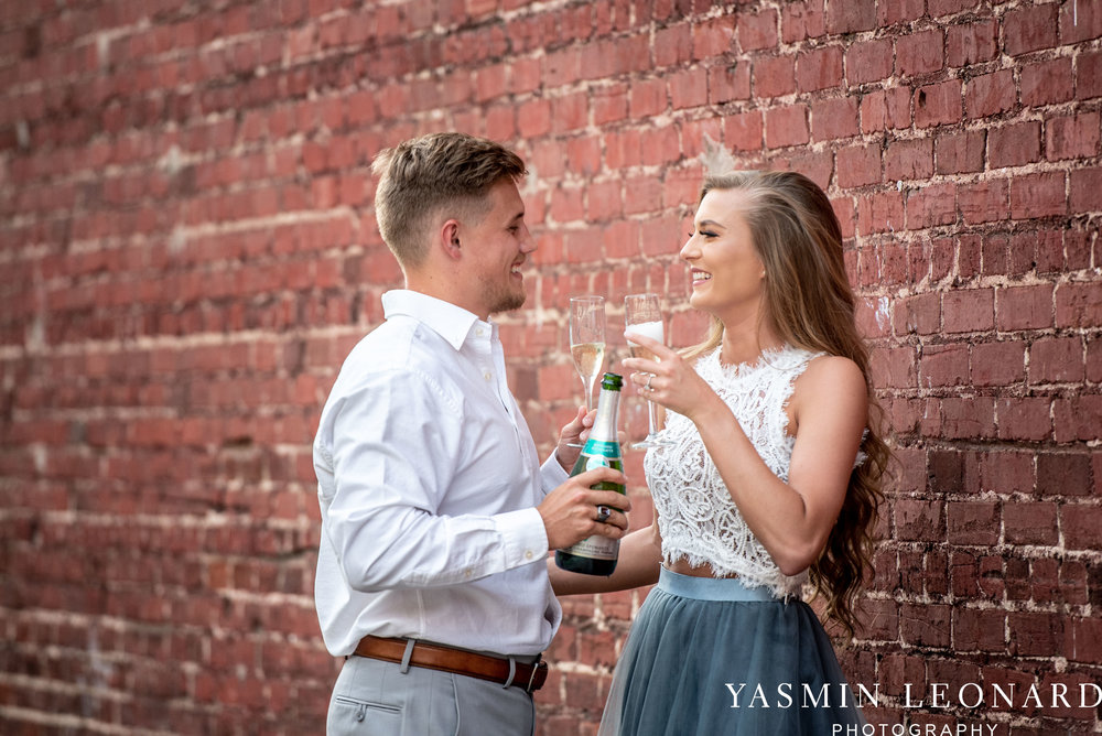Downtown Winston Salem - Winston Salem Engagement Session - Winston Salem NC - Engagement Session at Bailey Park - The Millennium Center - NC Wedding Venues - How to Engagement Session - Yasmin Leonard Photography-17.jpg