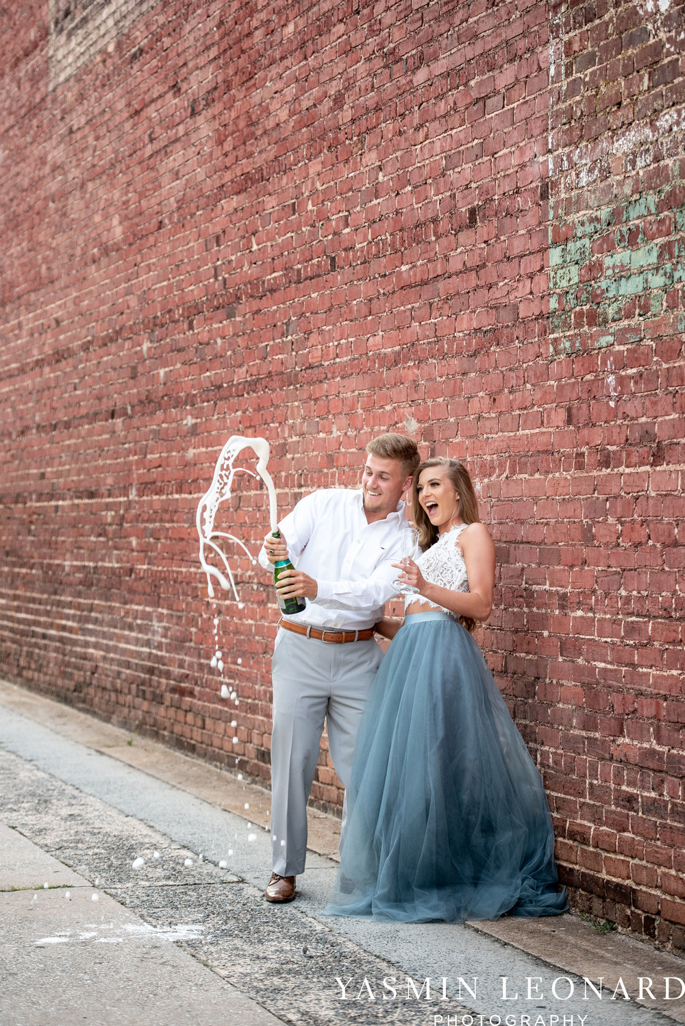 Downtown Winston Salem - Winston Salem Engagement Session - Winston Salem NC - Engagement Session at Bailey Park - The Millennium Center - NC Wedding Venues - How to Engagement Session - Yasmin Leonard Photography-16.jpg