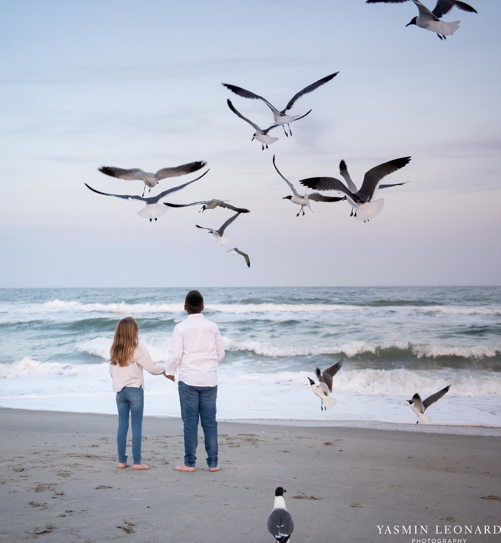 Sibling Beach Pictures - Caorlina Beach Portraits - Kure Beach Portraits - Sibling Beach Pictures - Family Pictures at the Beach - Seaguls and Children - Summer Picture Ideas - Sibling Poses-7.jpg