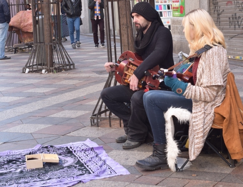You will see street musicians with traditional instruments—or not so common such the case of this couple.