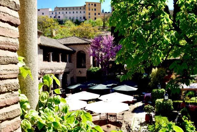 The rooms overlook the relaxing garden and patio area at the Hacienda del Cardenal.