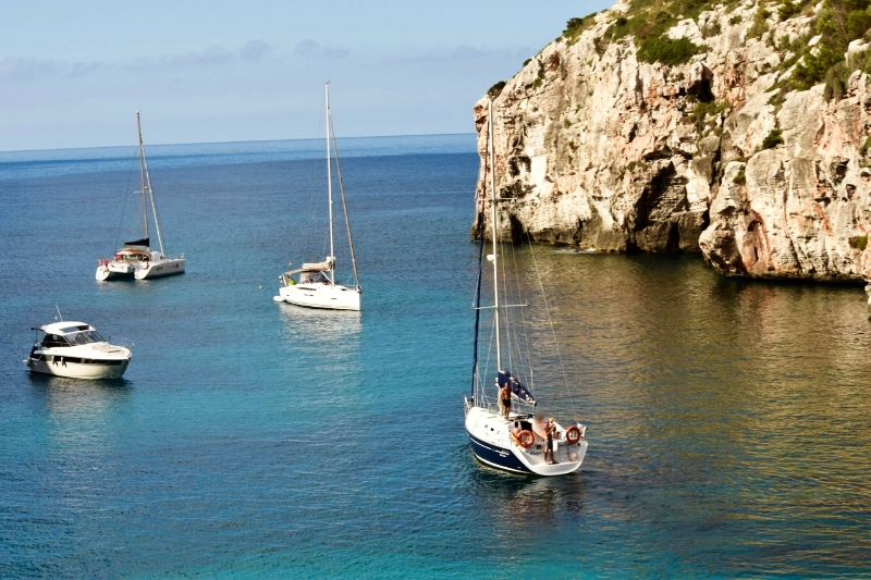 Cala Coves in Menorca doesn't have a large beach, but the clear waters in the picturesque canyon make it a favourite spot.