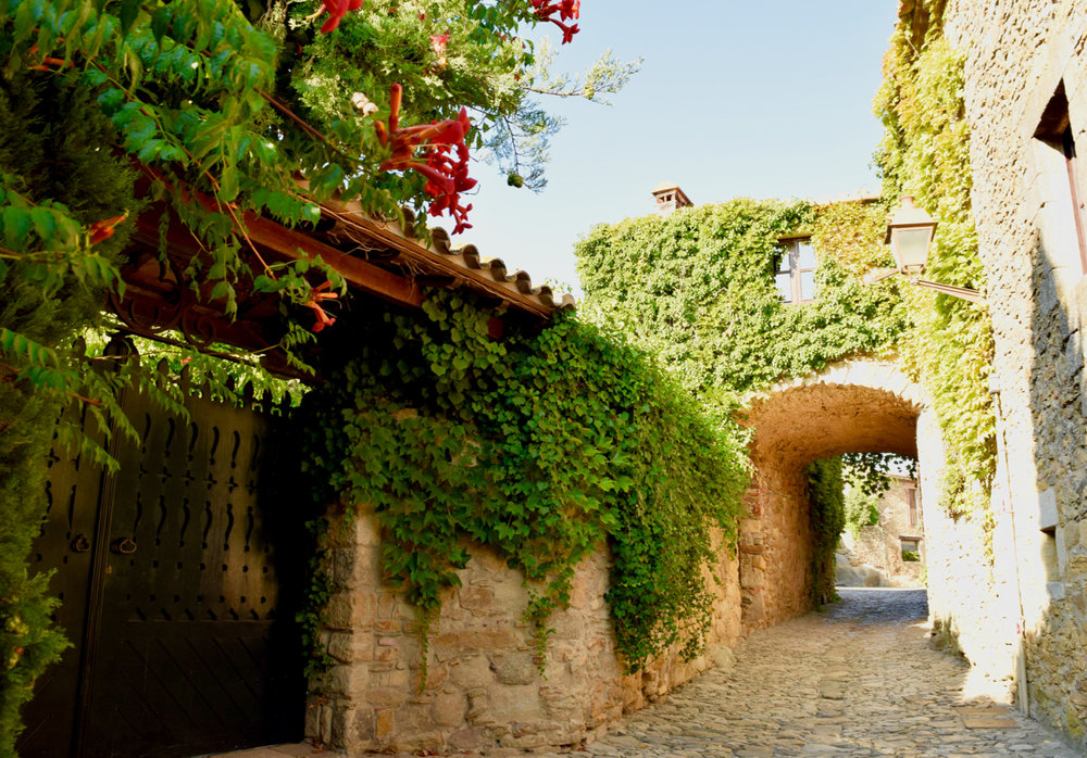 All of Peratallada has flowers, trailing plants and greenery covering the walls to add to the charm.
