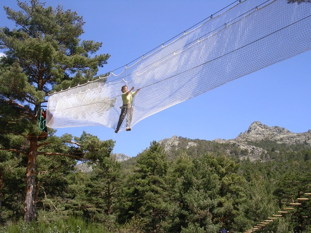 The web bridge on circuit 2 with a stunning view of the mountains behind (if you are brave enough to take a peak) at de Pino a Pino adventure Park. Photo courtesy de Pino a Pino