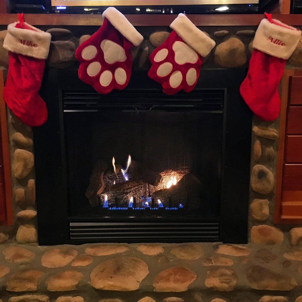 the fireplace with all of our stockings.