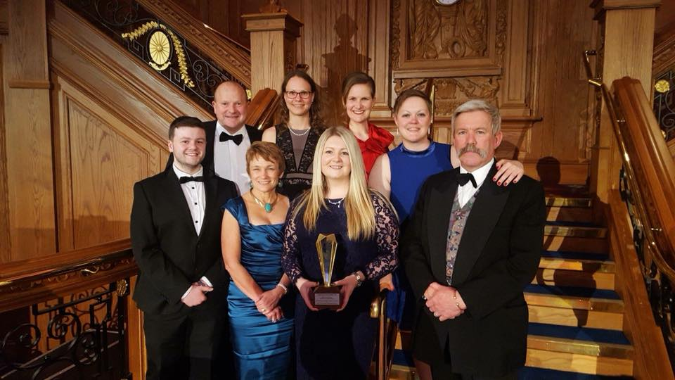 The research team with Peter Baillie receiving their award at Ulster University Impact Excellence Awards, Titanic Quarters Belfast.