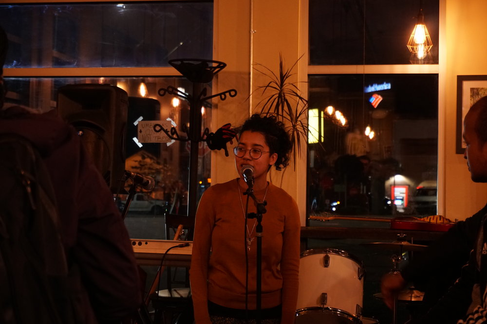 Azura Tyabji delivers wisdom through poetry at House Party 6. Photo by Mary Elworth