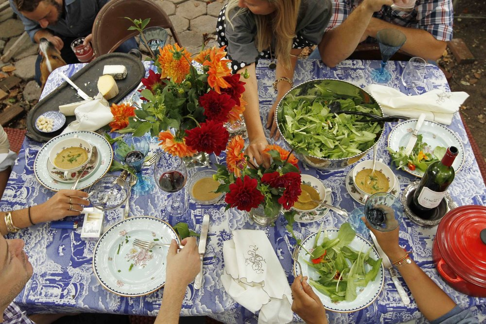 "And to conclude ""en beauté"" as the French say, here are some of Mieke's tips for a beautiful outdoor table:  1-  Outdoor Table Setting = Nothing's Set in Stone.  ""I do not have a separate set of china, linen, or glassware for eating al fresco. It's amazing the difference beautifully patterned tablecloth can make!"" she says.  2-  Fresh Cut Flowers Centerpiece.  ""I use all different kinds of vessels—I love my Frances Palmer vases, old jasperware pieces, and even egg cups! Whatever is charming and fills the right amount of negative space on the table. I relish the unstructured and  slightly chaotic.""  3-  A Great Salad Dressing.  ""Whisky 2 tablespoons sherry vinegar with 2 and a half teaspoons of dijon mustard. add half a teaspoon of freshly grated garlic (or slightly more, to taste), and finally 3 tablespoons of olive oil. add salt & pepper. whisk until it""."