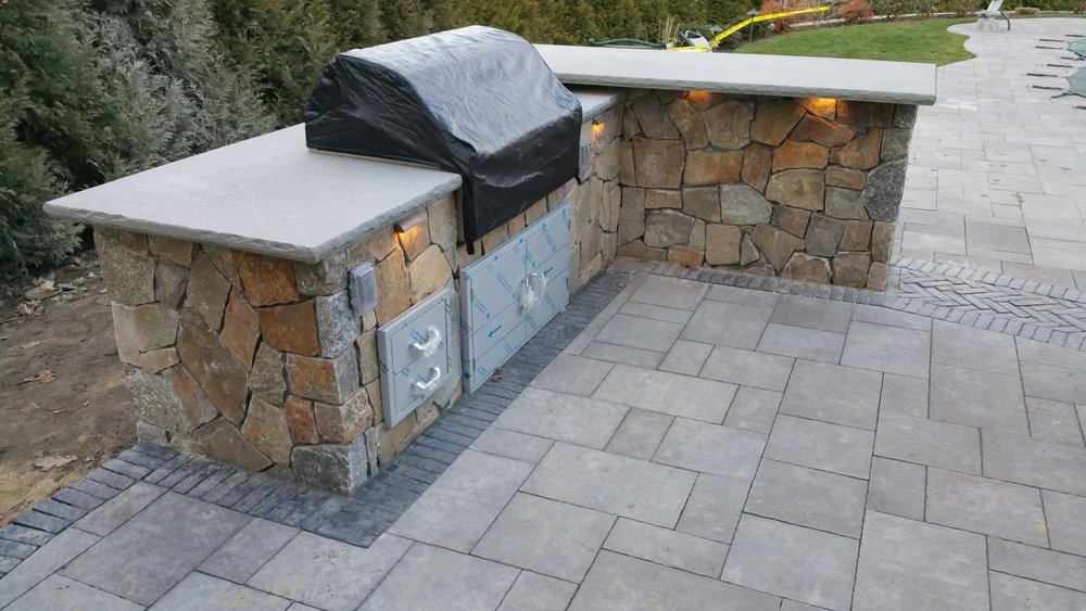 concrete pavers vs natural stone for your peekskill ny patio